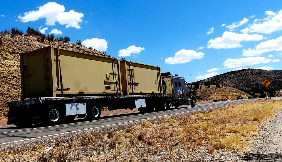 two trailers on flatbed truck